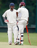 Shepherds Bush openers R Chadha (L) and N Naguleswaran discuss tactics during the Middlesex County League Division two game between Shepherds Bush and Hornsey at Bromyard Avenue, East Acton on Sat July 23, 2011