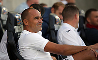 Former Swansea manager Roberto Martinez sits in the dug out during the Swansea Legends v Manchester United Legends at The Liberty Stadium, Swansea, Wales, UK. Wednesday 09 August 2017