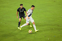 CARSON, CA - SEPTEMBER 15: Graham Zusi #8 of Sporting Kansas City defends Cristian Pavon #10 of the Los Angeles Galaxy during a game between Sporting Kansas City and Los Angeles Galaxy at Dignity Health Sports Complex on September 15, 2019 in Carson, California.