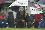 Padraig Harrington shelters while he waits to putt on the 3rd green during the final round of the Irish Open on 20th of May 2007 at the Adare Manor Hotel & Golf Resort, Co. Limerick, Ireland. (Photo by Eoin Clarke/NEWSFILE).