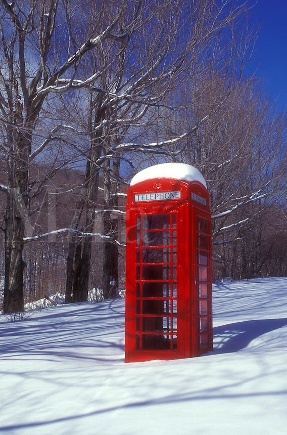 AJ5945, telephone booth, phone booth, winter, snow, A red telephone booth stands out in a field of snow on a beautiful sunny day in winter in Dorset in Bennington County in the state of Vermont.