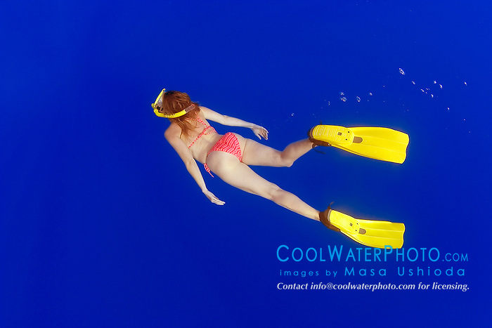 woman snorkeler in blue water, off Kona Coast, Big Island, Hawaii, Pacific Ocean