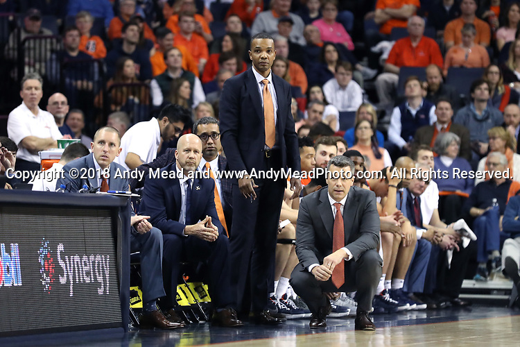 CHARLOTTESVILLE, VA - MARCH 03: Virginia head coach Tony Bennett (right) with assistants (from right) Ron Sanchez, Brad Soderberg, and Ronnie Wideman. The University of Virginia Cavaliers hosted the University of Notre Dame Fighting Irish on March 3, 2018 at John Paul Jones Arena in Charlottesville, VA in a Division I men's college basketball game. Virginia won the game 62-57.