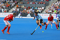 Pedro Ibarra of Argentina tries to block a shot from England's Ian Sloan during the Hockey World League Semi-Final match between England and Argentina at the Olympic Park, London, England on 18 June 2017. Photo by Steve McCarthy.