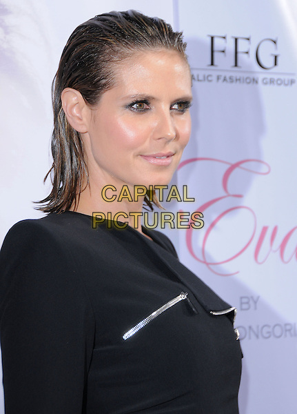 HEIDI KLUM.The Eva by Eva Longoria Fragrance Launch held at Beso in Hollywood, California, USA. .April 27th, 2010.perfume headshot portrait black eyeliner make-up wet hair slicked back .CAP/RKE/DVS.©DVS/RockinExposures/Capital Pictures.