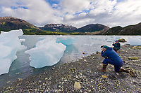 Tourists view and photograph stranded icebergs in Nellie Juan Lagoon, Prince William Sound, southcentral, Alaska.