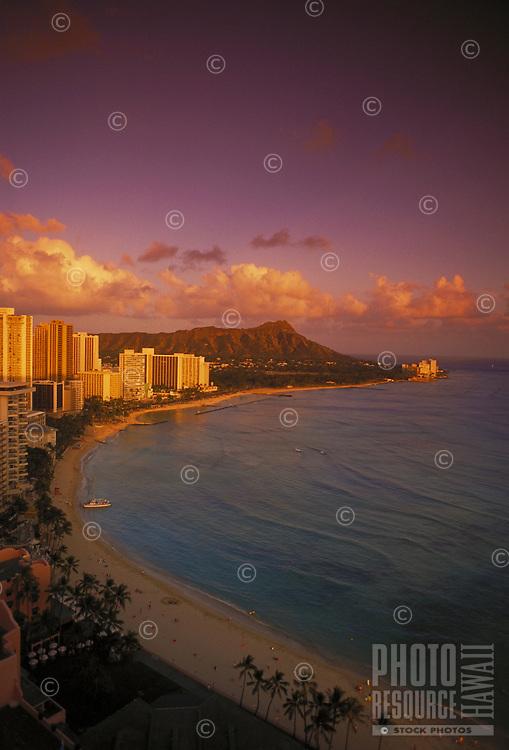Waikiki beach with Diamond head and hotels at dusk, Oahu