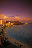Waikiki beach with Diamond head and hotels at dusk, Oahu