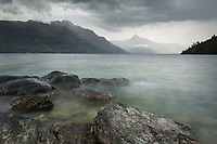 Moody scene at Lake Wakatipu with Walter Peak in distance, Queenstown Central Otago, South Island, New Zealand, NZ