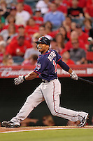 Minnesota Twins outfielder Ben Revere #11 bats against the Los Angeles Angels at Angel Stadium on September 2, 2011 in Anaheim,California. Minnesota defeated Los Angeles 13-5.(Larry Goren/Four Seam Images)