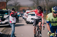 Frederik Frison (BEL/Lotto-Soudal) snagging his musette in the feedzone<br /> <br /> 81st Gent-Wevelgem in Flanders Fields (1.UWT)<br /> Deinze &gt; Wevelgem (251km)