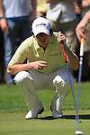 Rory McIlroy eyeing up his putt on the 4th.during round three of the BMW PGA championship 2010 at Wentworth golf club, Surrey England..Picture Fran Caffrey/Newsfile.ie