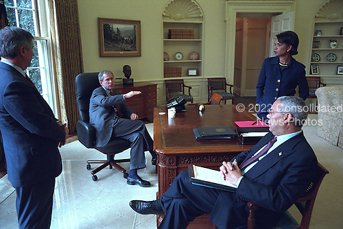 United States President George W. Bush meets White House Chief of Staff Andy Card, far right, U.S. Secretary of State Colin Powell, center, and National Security Advisor Dr. Condoleezza Rice in the Oval Office of the White House in Washington, D.C. on Wednesday, December 12, 2001..Mandatory Credit: Eric Draper - White House via CNP.