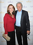 Bruce Boxleitner and date at 'The Christmas Ornament Premiere' at La Piazza Restaurant at the Grove in Los Angeles, Ca. November 13, 2013