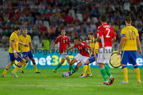 Hungary's Gergely Rudolf (L) and Adam Pinter (C) fight for the ball with Sweden's Kim Kallstrom (R) during the UEFA EURO 2012 Group E qualifier Hungary playing against Sweden in Budapest, Hungary on September 02, 2011. ATTILA VOLGYI