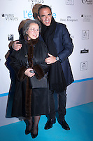 French-Greek TV host Nikos Aliagas (R) and his mother Harula pose during a photo call for the opening of Aliagas' photography exhibition, on January 16, 2017, in Paris.