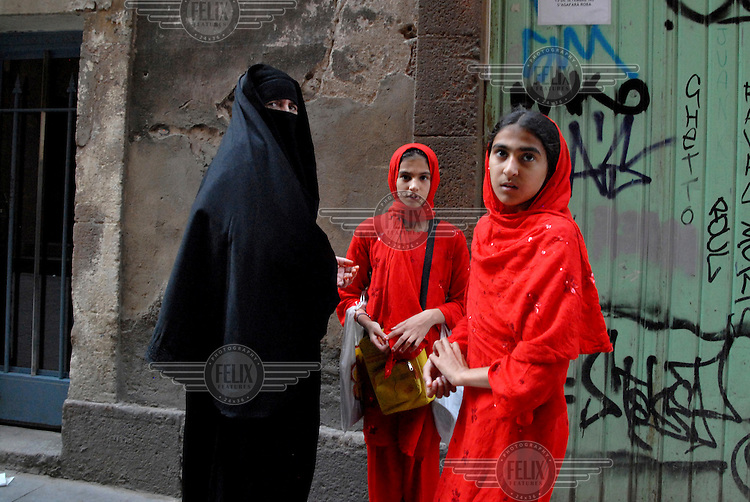 Women and children wear niqabs, a style of dress which may be banned in Barcelona in the future.