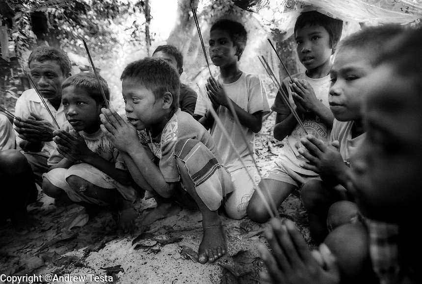 Moken children take part in a prayer ceremony at one of the Moken Graveyards on Surin Island..©Andrew Testa