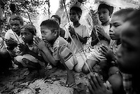 Moken children take part in a prayer ceremony at one of the Moken Graveyards on Surin Island..©Andrew Testa