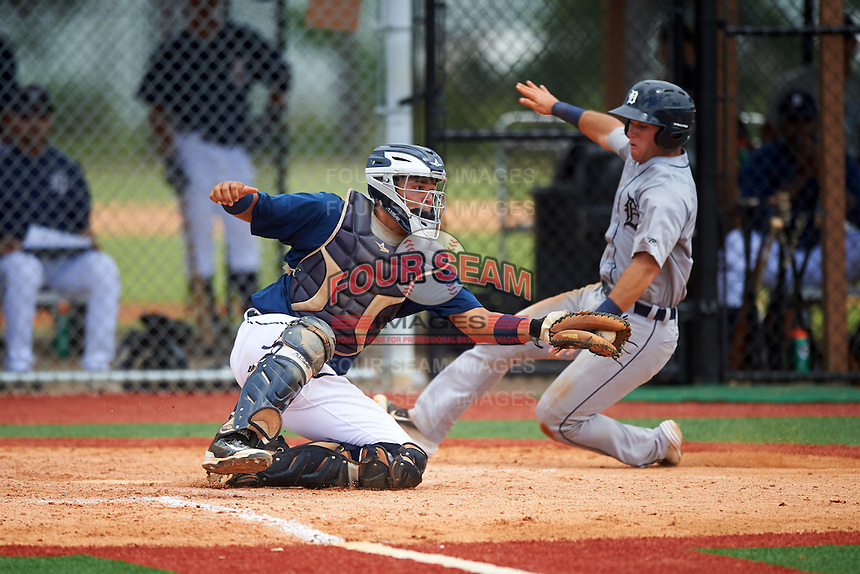 GCL Tigers East catcher Elys Escobar (22) catches a throw as Chad Sedio slides home safely on a sac fly during a game against the GCL Tigers West on August 4, 2016 at Tigertown in Lakeland, Florida.  GCL Tigers West defeated GCL Tigers East 7-3.  (Mike Janes/Four Seam Images)