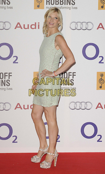 Jo Whiley.The Nordoff Robbins O2 Silver Clef Awards 2012, London Hilton Park Lane Hotel, London, England..June 29th, 2012.full length white grey gray sleeveless dress hand on hip side .CAP/CAN.©Can Nguyen/Capital Pictures.