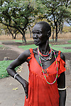 SOUTH SUDAN Rumbek , Dinka village, woman in red dress and necklace / SUED SUDAN Rumbek,  Dinka Dorf Colocok, Frauim roten Kleid umd mit Halsschmuck