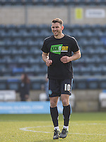 Matt Bloomfield of Wycombe Wanderers warms up in the Kick it Out Shirt during the Sky Bet League 2 match between Wycombe Wanderers and Stevenage at Adams Park, High Wycombe, England on 12 March 2016. Photo by Andy Rowland/PRiME Media Images.