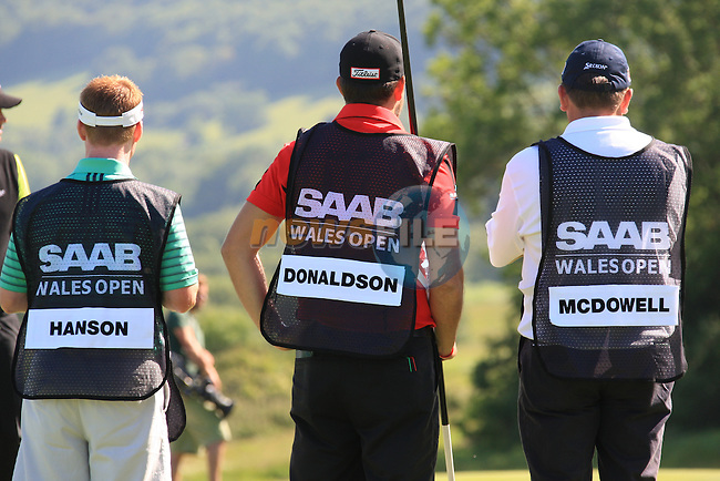 Hanson, Donaldson and McDowell Caddies on the 17th.on day one of the Saab Wales Open at Celtic Manor 2010 course Newport, Wales. 2/6/11.Picture: Fran Caffrey/ www.golffile.ie .