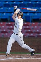 Austin Stadler #9 of the Wake Forest Demon Deacons follows through on his swing against the North Carolina State Wolfpack at Wake Forest Baseball Park March 19, 2010, in Winston-Salem, North Carolina.  Photo by Brian Westerholt / Four Seam Images
