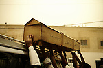 BAGHDAD, Iraq: 13th June 2014<br /> <br /> The coffin of a decease man from Baghdad's morgue is strapped to the roof of a silver mini van.The circumstances of the death are unknown, however, it is assumed to be non-violent. <br /> <br /> Morgue workers say that Baghdad has not yet returned to its darkest days after 2006, when Shiite and Sunni sectarian death squads killed at whim, and dozens of bodies were dumped in the streets every day, but they are seeing more unidentified victims killed violently, especially since June, from across the capital.  <br /> <br /> <br /> Fixer: Haider Kata +9647704425647<br /> <br /> Ayman Oghanna for National Geographic