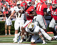 ATHENS, GA - SEPTEMBER 7: Brian Herrien #35 runs for a touchdown over Murray State player Dior Johnson #9 during a game between Murray State Racers and University of Georgia Bulldogs at Sanford Stadium on September 7, 2019 in Athens, Georgia.