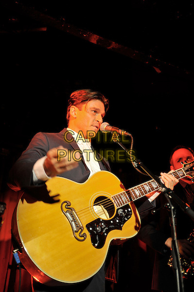 Didier Casnati of Gypsy Queens performing at Madame JoJo, Soho, Lodon, England. .20th September 2012.on stage in concert live gig performance music half length black grey gray suit jacket white shirt guitar singing profile .CAP/MAR.© Martin Harris/Capital Pictures.