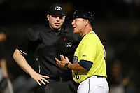 Manager Pedro Lopez (16) of the Columbia Fireflies has a disagreement with umpire Mitchell Leikam over a foul ball during a game against the Delmarva Shorebirds on Thursday, May 2, 2019, at Segra Park in Columbia, South Carolina. Delmarva won, 1-0. (Tom Priddy/Four Seam Images)