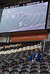 Hull City 3 Preston North End 0, 10/11/2007. KC Stadium, Championship. A Preston fan enjoys his own company. Photo by Paul Thompson.