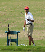 Kailua, Hawaii - December 29, 2008 -- United States President-elect Barack Obama acknowledges the traveling media pool as he warms up on the driving range to play golf with friends in Kailua, Hawaii on Monday, December 29, 2008. Obama and his family arrived in his native Hawaii December 20 for the Christmas holiday..Credit: Joaquin Siopack - Pool via CNP