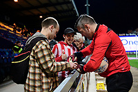 Lincoln City's Matt Gilks signs autographs for Lincoln City fans prior to the game<br /> <br /> Photographer Chris Vaughan/CameraSport<br /> <br /> The EFL Sky Bet League Two - Mansfield Town v Lincoln City - Monday 18th March 2019 - Field Mill - Mansfield<br /> <br /> World Copyright © 2019 CameraSport. All rights reserved. 43 Linden Ave. Countesthorpe. Leicester. England. LE8 5PG - Tel: +44 (0) 116 277 4147 - admin@camerasport.com - www.camerasport.com