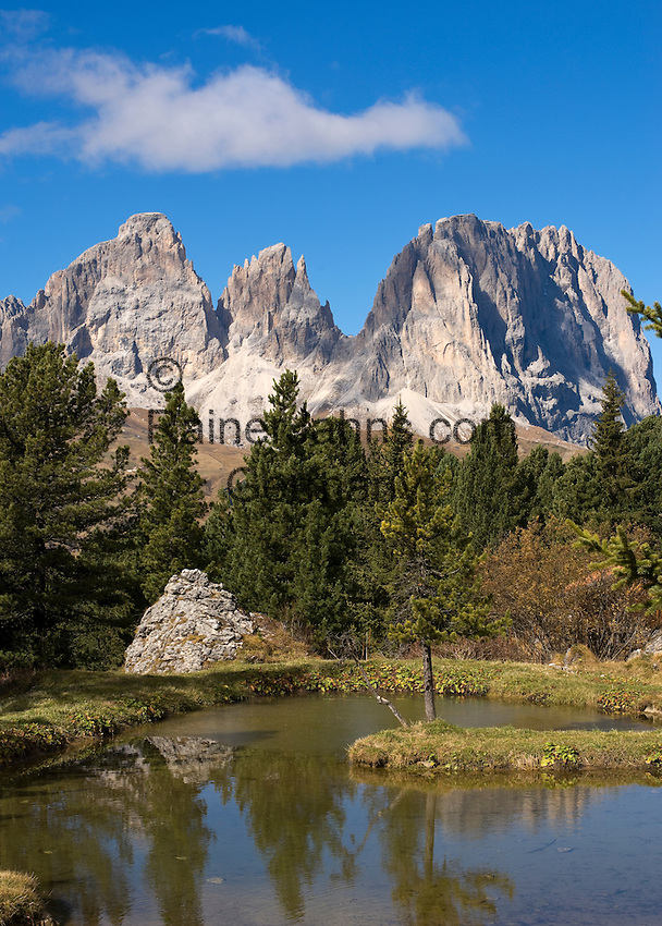 Italy, South-Tyrol, Trentino, Dolomites, small mountain pond, autumn mood, Gruppo Sassolungo mountains in Alto Adige