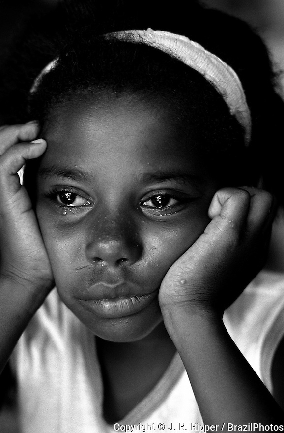 Black girl crying.