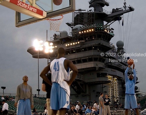 College basketball players from the University of North Carolina practice Thursday, November 10, 2011 aboard the Nimitz-class aircraft carrier USS Carl Vinson (CVN 70) in San Diego, California. Carl Vinson is hosting the Michigan State University Spartans and the University of North Carolina Tar Heels for the inaugural Quicken Loans Carrier Classic basketball game on Veteran's Day, November 11. United States President Barack Obama and first lady Michelle Obama are scheduled to attend the game..Mandatory Credit: Karolina A. Martinez - U.S. Navy via CNP