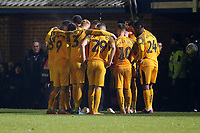 Newport players huddle after a injury to Kyle Howkins during Maldon & Tiptree vs Newport County, Emirates FA Cup Football at the Wallace Binder Ground on 29th November 2019