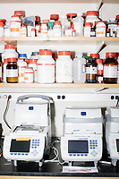 Bottles of chemicals stand on a shelf in George Church's Lab in the New Research Building at Harvard Medical School's Department of Genetics in Boston, Massachusetts, USA, on Tues., Sept. 5, 2017.