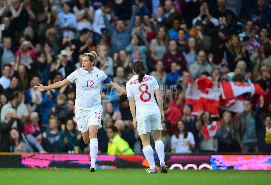 Aug 6, 2012; Manchester , United Kingdom; Canada forward (12) Christine Sinclair celebrates her first half goal against USA in the semi finals during the London 2012 Olympic Games at Old Trafford. Mandatory Credit: Mark J. Rebilas-USA TODAY Sports