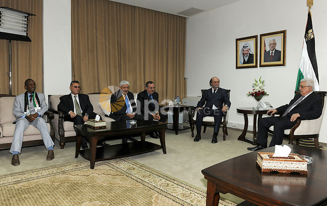 Palestinian President Mahmoud Abbas (Abu Mazen) meets with the head of International Federation of Sports Media in the West Bank city of Ramallah on May 14, 2011. Photo by Thaer Ganaim