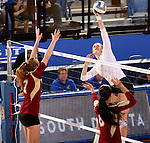 BROOKINGS, SD - OCTOBER 3:  Nola Basey #7 and Monique Domme #6 from Denver look to block a kill attempt by Carley Gerving #9 from South Dakota State University in the first game of their match Friday night at Frost Arena. (Photo/Dave Eggen/Inertia)