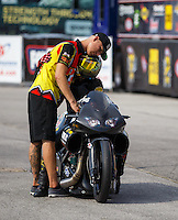 Sep 25, 2016; Madison, IL, USA; NHRA pro stock motorcycle rider Angelle Sampey is consoled by teammate Cory Reed as she reacts after red lighting and losing in the final round of the Midwest Nationals at Gateway Motorsports Park. Mandatory Credit: Mark J. Rebilas-USA TODAY Sports