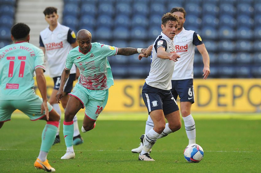 Preston North End's Ryan Ledson under pressure from Swansea City's Andre Ayew<br /> <br /> Photographer Kevin Barnes/CameraSport<br /> <br /> The EFL Sky Bet Championship - Preston North End v Swansea City - Saturday September 12th 2020 - Deepdale - Preston<br /> <br /> World Copyright © 2020 CameraSport. All rights reserved. 43 Linden Ave. Countesthorpe. Leicester. England. LE8 5PG - Tel: +44 (0) 116 277 4147 - admin@camerasport.com - www.camerasport.com