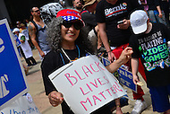 "Philadelphia, PA - July 26, 2016: Noiree Krikorian, or Seatle, Washington, holds a ""Black Lives Matter"" sign at a ""Bernie or Bust"" rally across from City Hall during the Democratic National Convention in Philadelphia, PA, July 26, 2016  (Photo by Don Baxter/Media Images International)"
