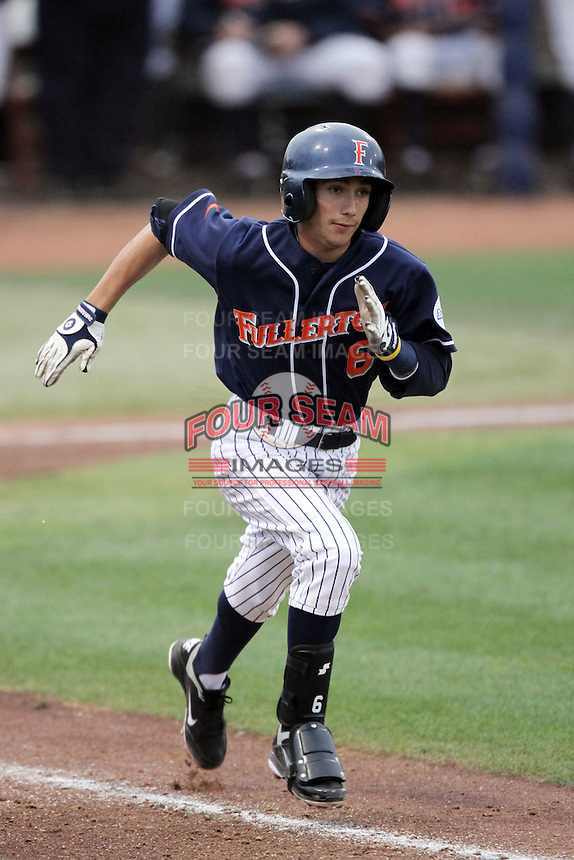 Richie Pedroza #6 of the Cal. St. Fullerton Titans runs the bases during game against the Cal. St. Long Beach 49'ers at Goodwin Field in Fullerton,California on May 14, 2011. Photo by Larry Goren/Four Seam Images
