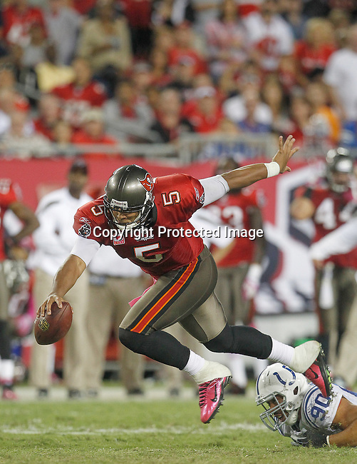 Tampa Bay Buccaneers quarterback Josh Freeman (5) lunges for a first down in the fourth quarter against the Indianapolis Colts.  The Buccaneers defeated the Colts 24-17 in an NFL game, Monday, Oct. 3, 2011 in Tampa, Fla. (AP Photo/Margaret Bowles)