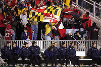 Maryland fans celebrate in the background of the SMU bench. The University of Maryland defeated Southern Methodist University 4-1 in the NCAA Semifinal at SAS Stadium in Cary, North Carolina, Friday, December 9, 2005.